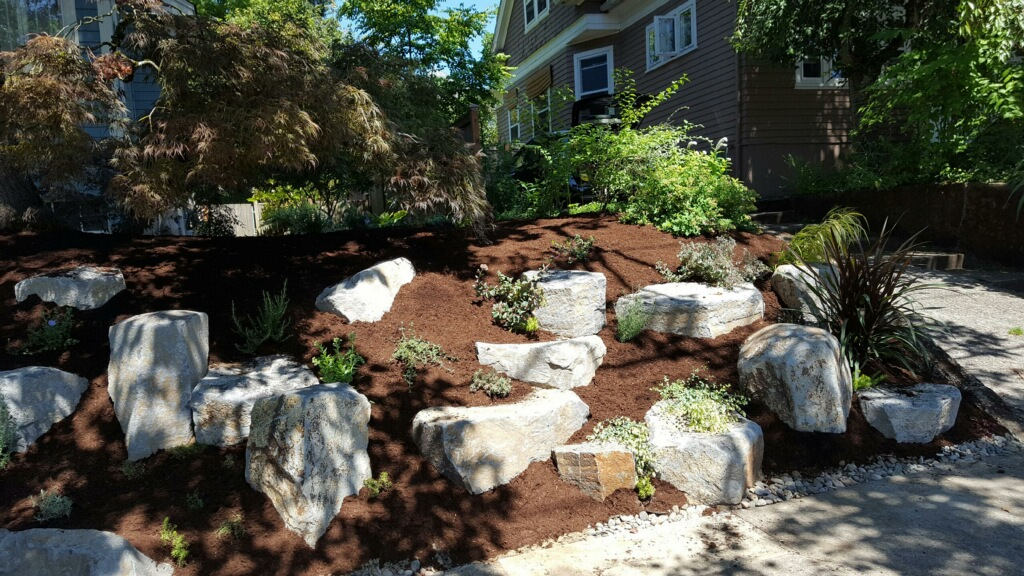 NW Wodland Cottage Garden, after, boulders, front slope